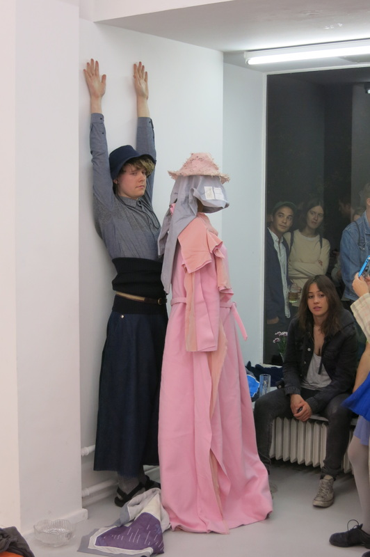 matthew linde in anna sofie bergers performance piece, 'tell me what to do'  hbpeace shirt and atop laura fanning dress hbpeace scarf in foreground.