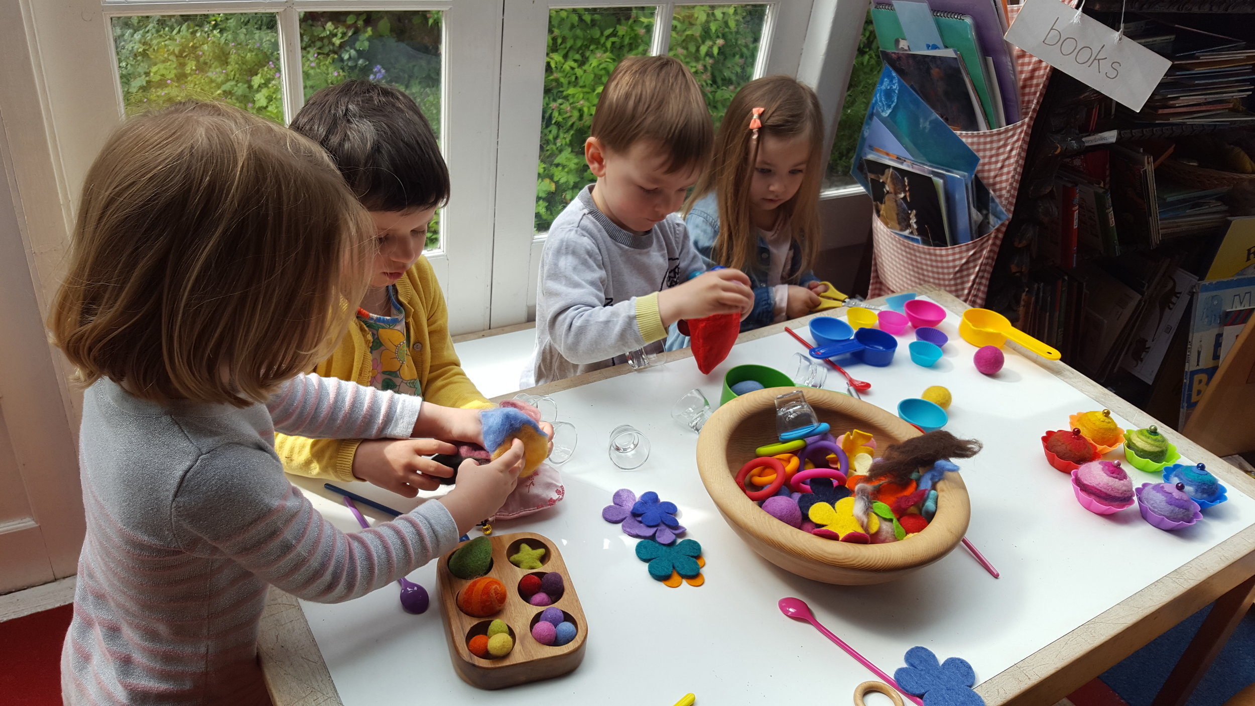 Children sort, count and match with lovely sensory wool balls and felted cakes