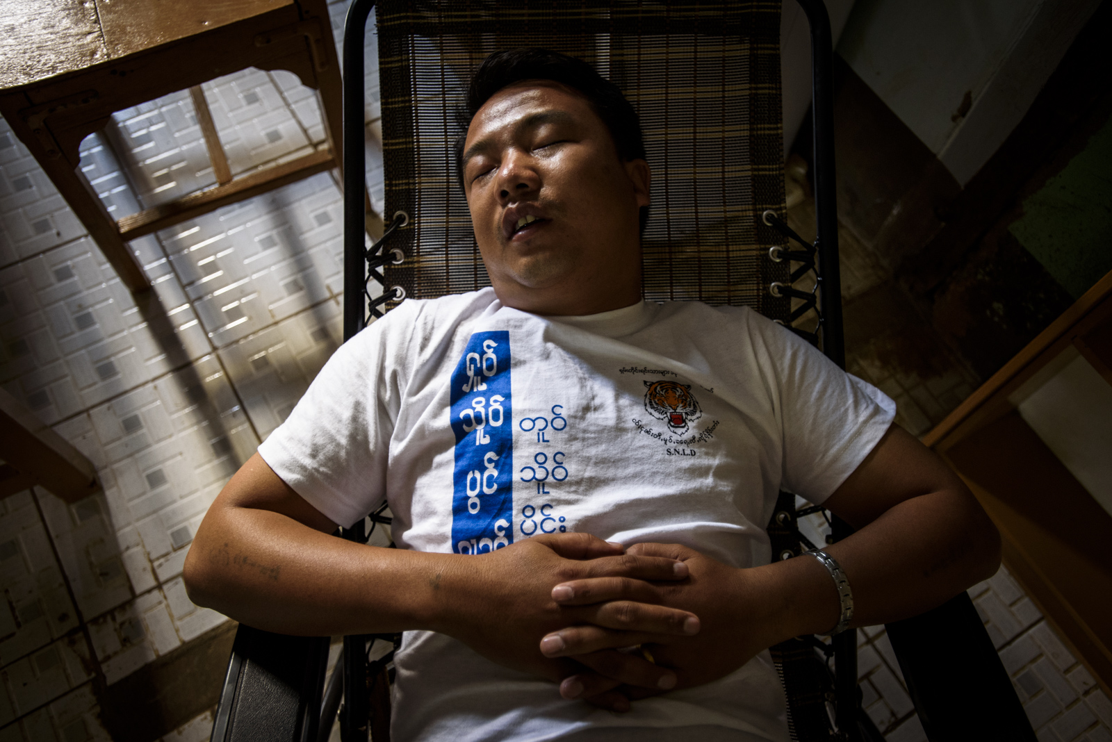 One Leng takes a nap at the SNLD headquarters in Lashio, Myanmar.