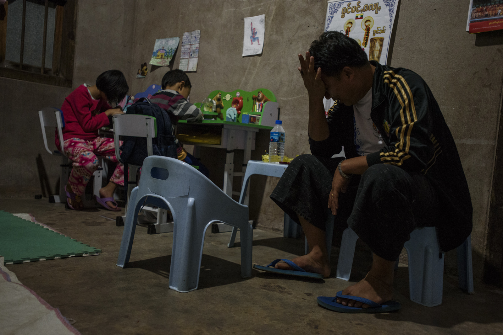 One Leng at home at the end of a day of campaigning, His children are doing their homework, but have taken some days off school to help their father.