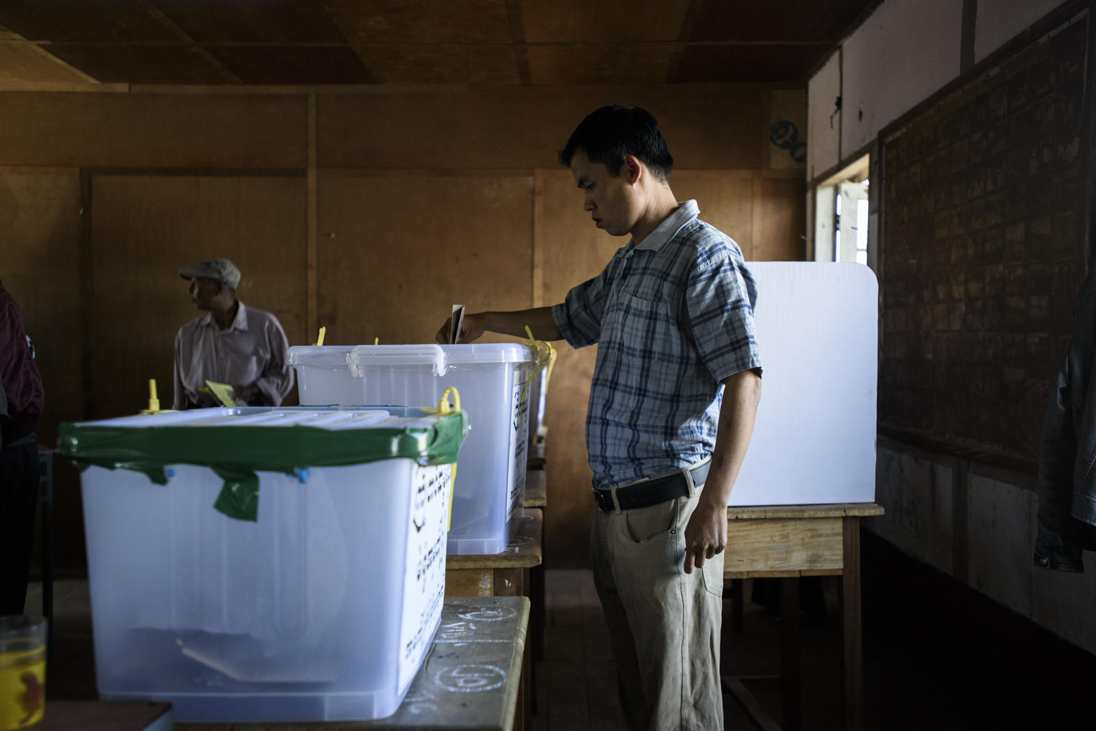 A man casts a ballot at a polling station in One Leng's district in Lashio, Myanmar.