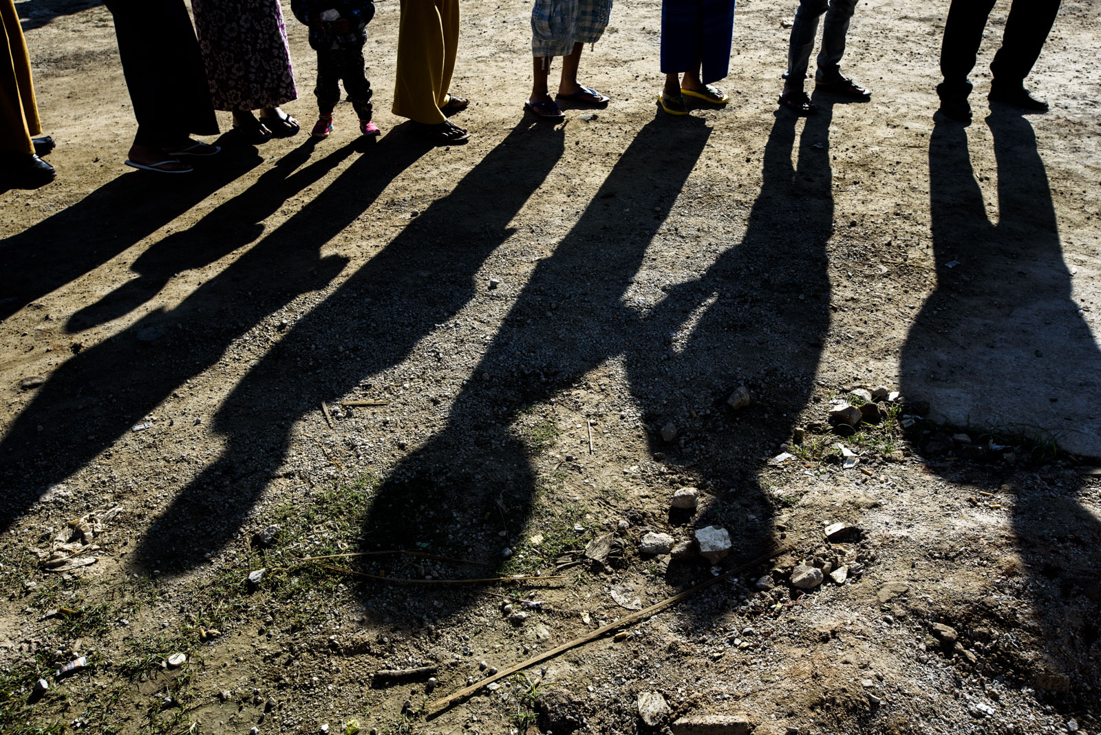 People wait on line at a polling station in One Leng's district.