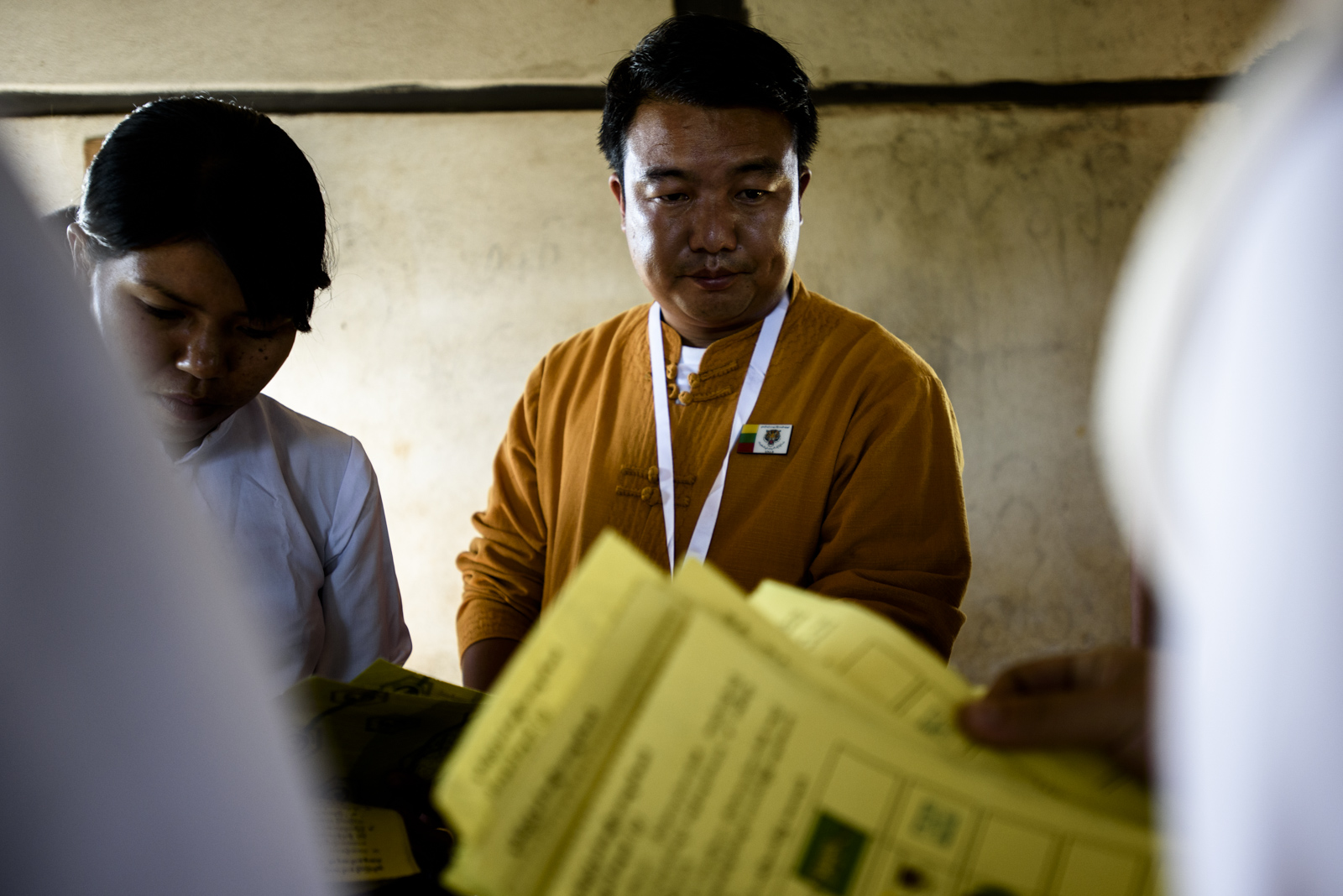 One Leng watches election officials counting ballots for the seat he is contesting at a rural polling station in Kan Long, Myanmar. He received 411 votes while Aung San Suu Kyi's NLD had only three.