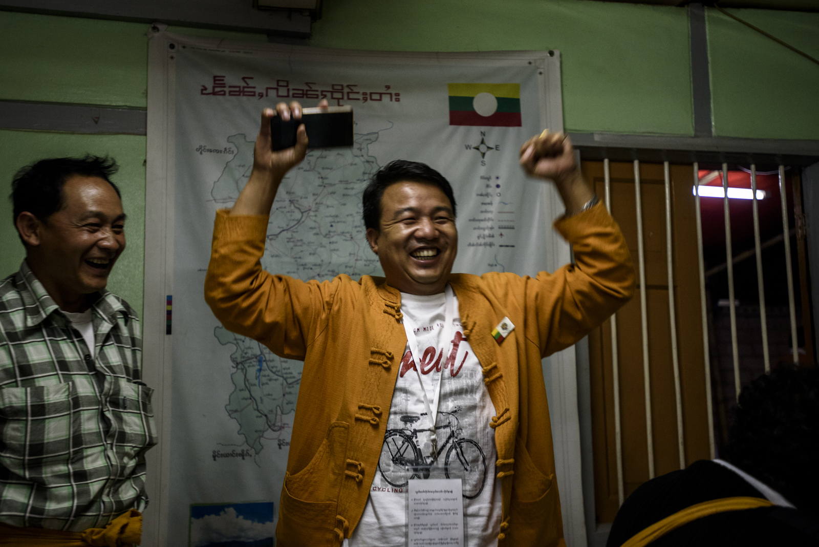 One Leng celebrates after learning he received the most votes at one of the polling stations in downtown Lashio. The tally is still unofficial and there are 129 in the city.