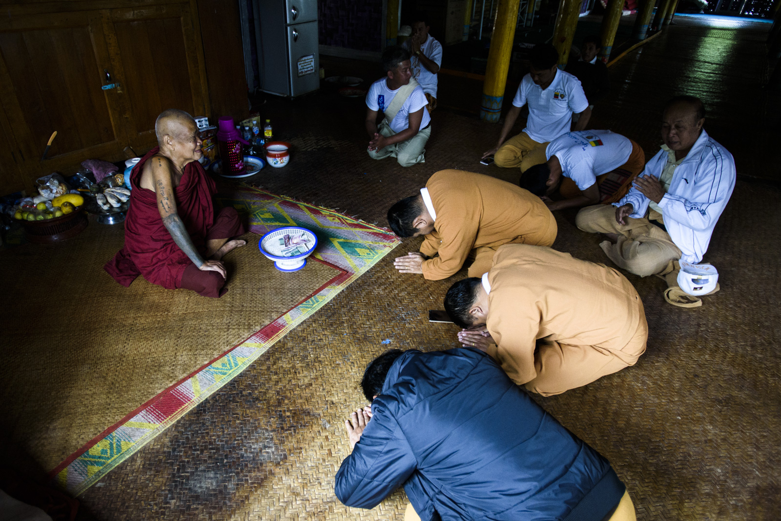 One Leng pays tribute to a Buddhist monk where the Shan Nationalities League for Democracy held an event to talk to voters.