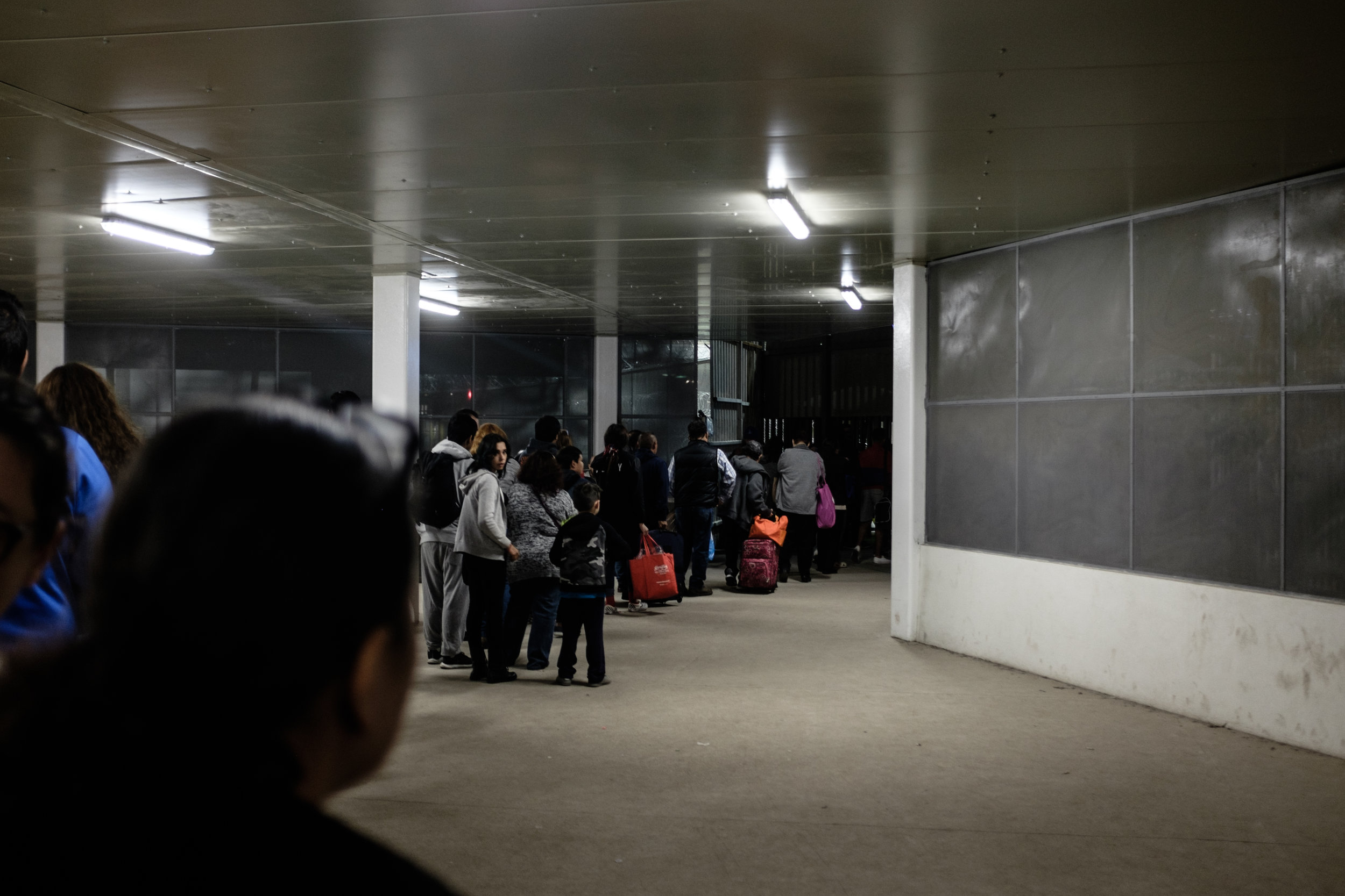 Travelers waiting to enter the US from Mexicali, Mexico