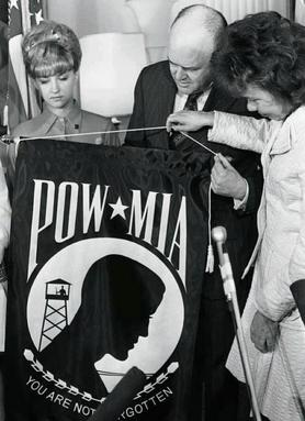 Evelyn Grubb presents an early rendition of the new flag to Defense Secretary Melvin Laird