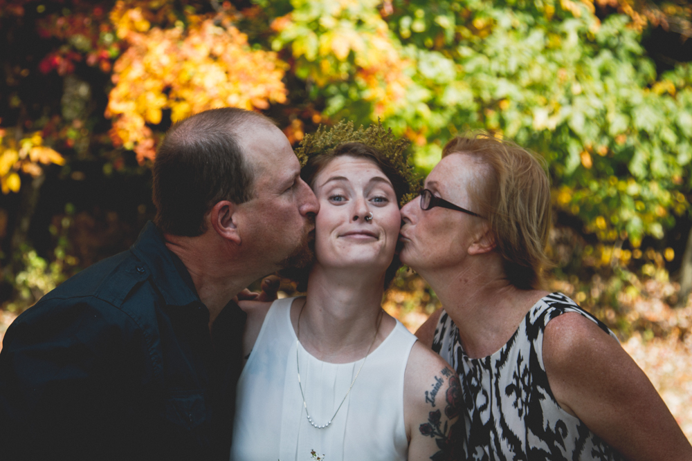 Kisses from my parents at our wedding.