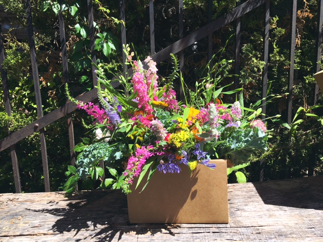 A simple brown box is great for transporting multiple vases or even one arrangement (nobody wants spilled flowers and water all over their car!).