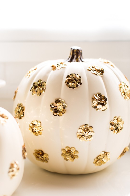 Gold sequins on a white pumpkin add a girly touch. Photo:  Sugar and Cloth