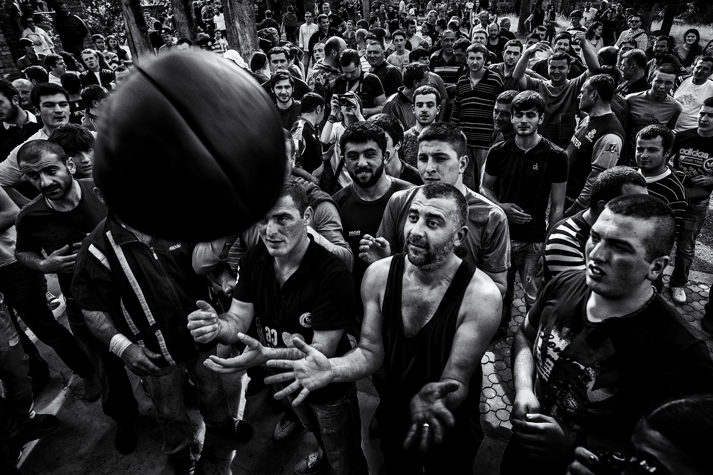 People are looking forward to the game the whole year. As the ball is made only few hours before, players doesn't have the chance to practice but few minutes before game starts. Happiness and fear can being seen in players faces. Shukhuti, Georgia, April 2014.