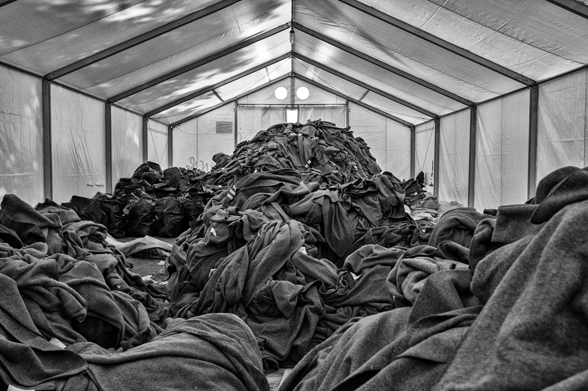 "A NGO tent in Idomeni, packed with old blankets. ""The lack of coordination between NGOS and government is heartbreaking, no one really knows what is going on, when we ask we can not get any clear answer about what it's really happening"" Ahmed Moavia of the Greek Forum for migrants in Athens. Idomeni, Greece, January 2016."