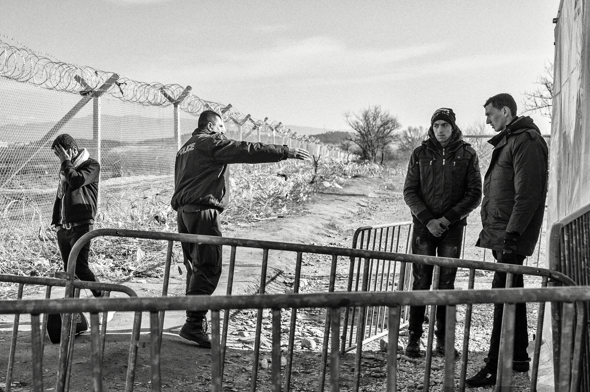 A Syrian man (left) waits to cross the border of Idomeni after he was separated from his family and friends. A problem with its statement was found by Greek Police and Frontex, an european agency that helps the greek government to control its borders. Since december 2015 border controls has tightened. Idomeni, Greece, January 2016.