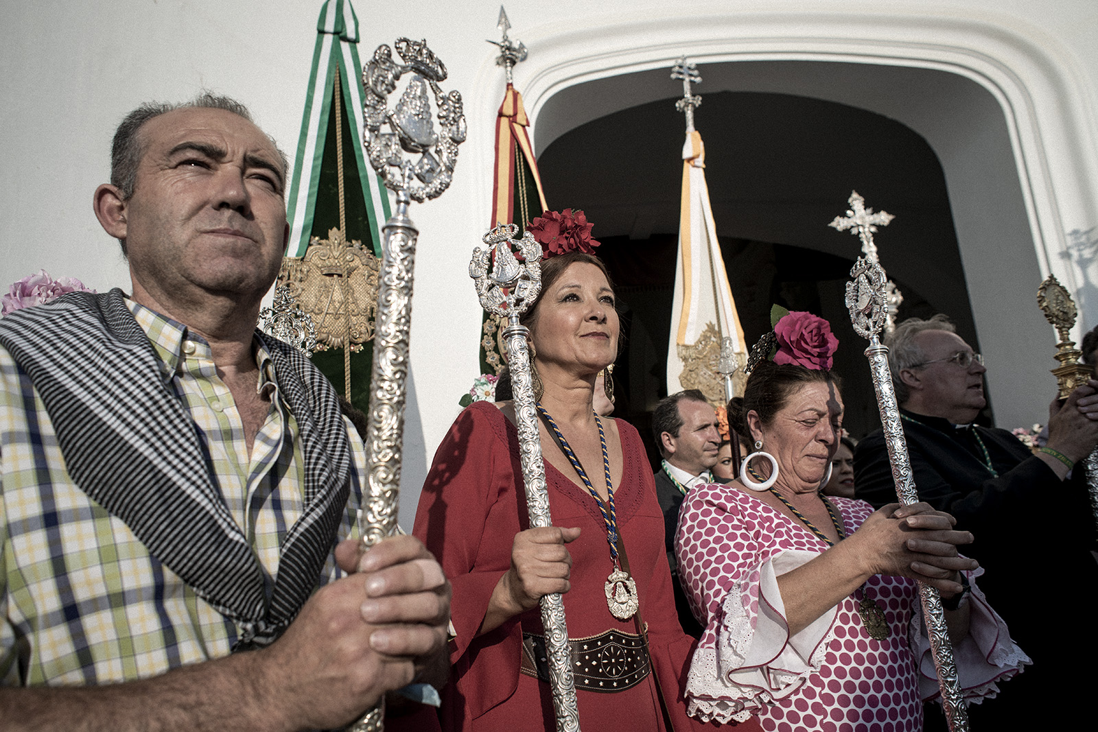 Each brotherhood has its own committee in charge, usually the ones carrying decorated metal batons. As each brotherhood arrives to town they have to offer their respects to the Holy Mary. The big square in front of the hermitage serves as stage of the offerings. El Rocío, Spain, May 2015.