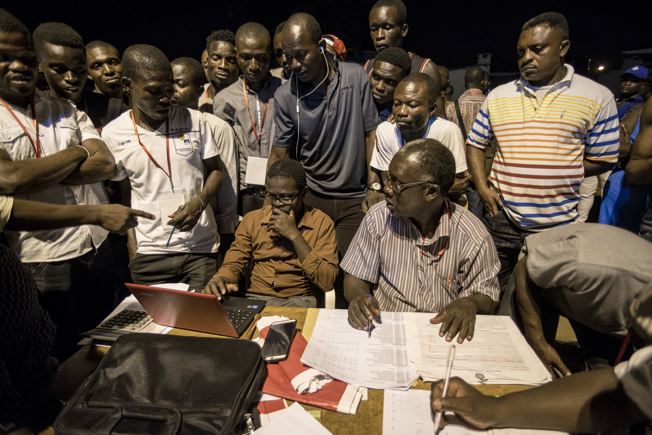 Election Commission officers gather in a Coalition Center in Teshie neighbourhood, Accra, to prepare for counting casted ballots