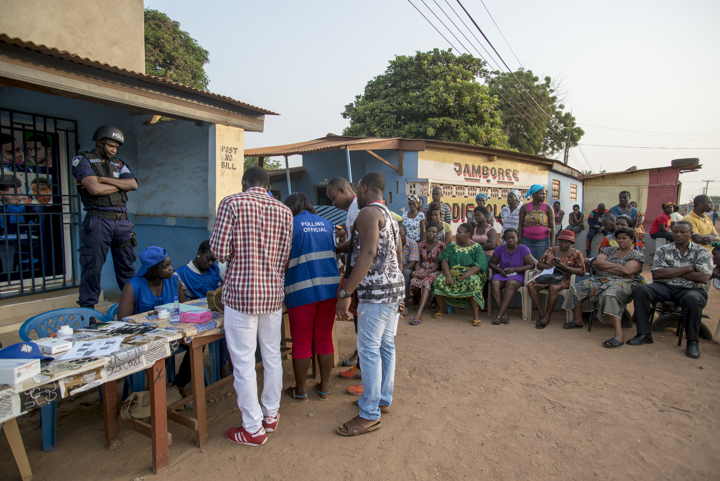 Electoral commission officers preparing Eddie Polo's Jamboree polling station in Accra during the General Election day. Each polling station is secured with police officers and security