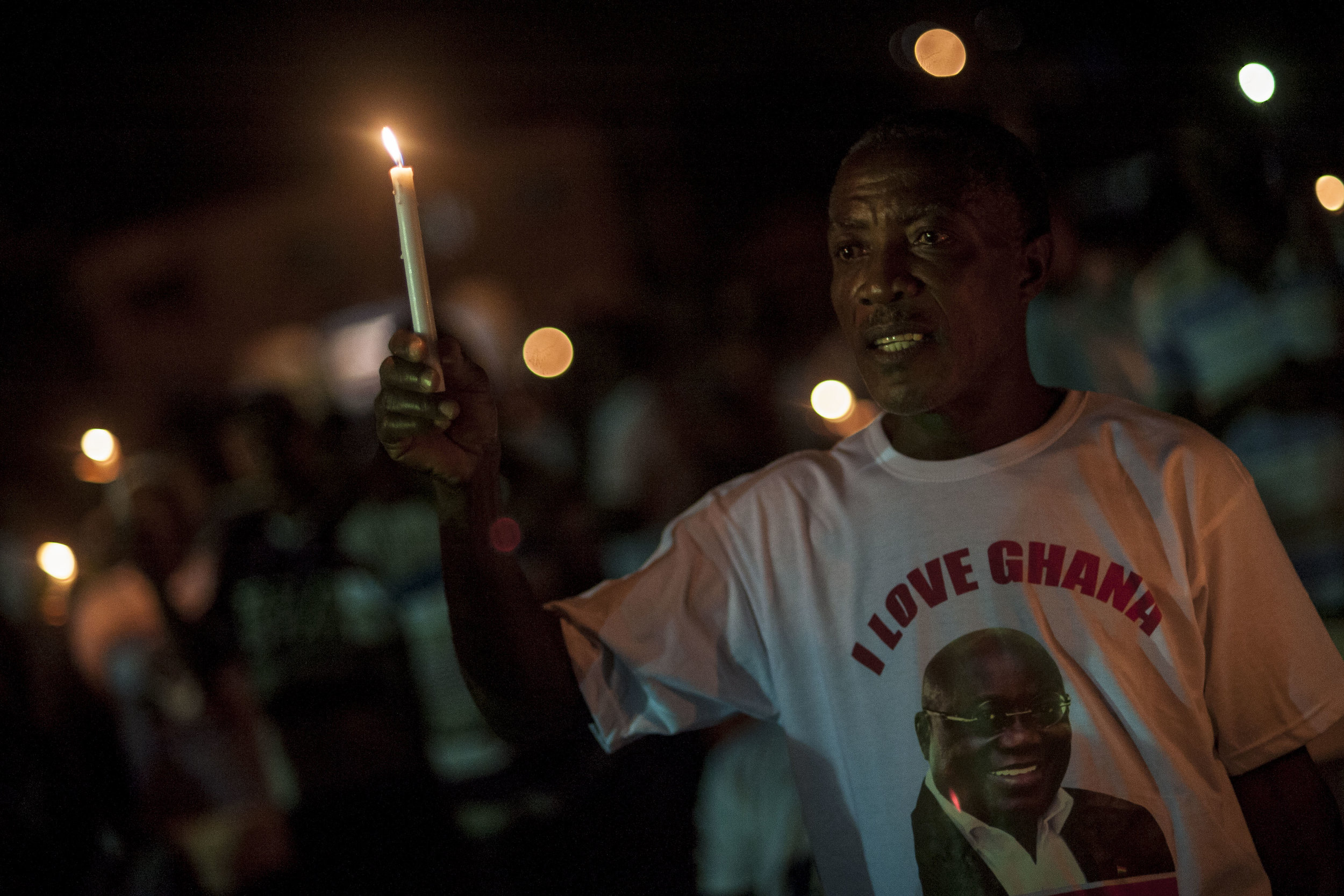 NPP Supporter with a t-shirt of Nana Akufo-Addo, New Patriotic Party (NPP) main candidate for the next general election on 7th December, pray during a religious ceremony in Koforidua, Ghana