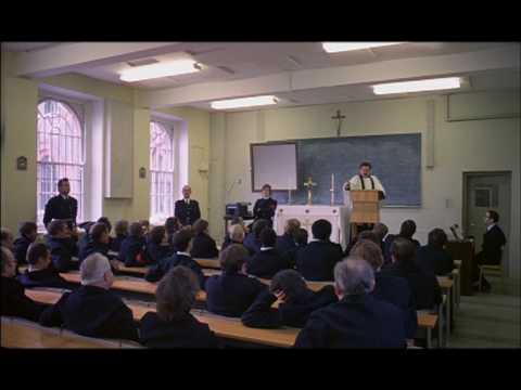 Prison Chaplain addressing prisoners
