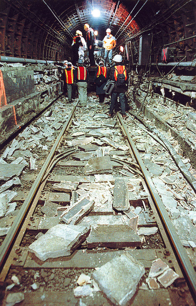 Engineers from Port Authority of NY and NJ walk the entire length of train tracks inside the PATH tunnel from Exchange Place in Jersey City to the World Trade Center station in New York City, which were flooded with water from the 9/11 attacks on May 2, 2002. The tunnel was reopened on June 29, 2003. Photograph by Bill Bayer /  The Jersey Journal .