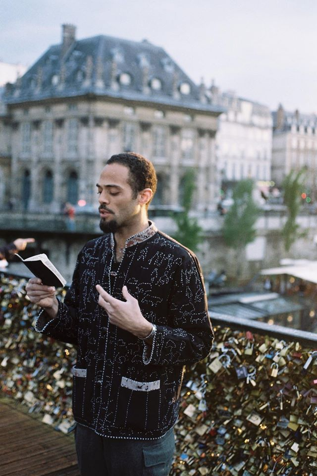 Malik reading in Paris. Image courtesy of the artist.