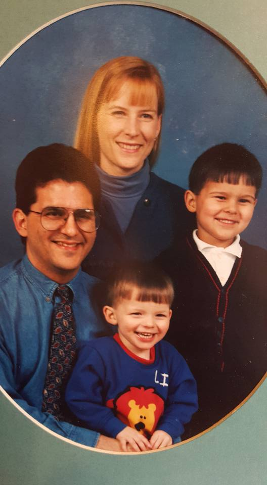 Young Max on right with family.jpg