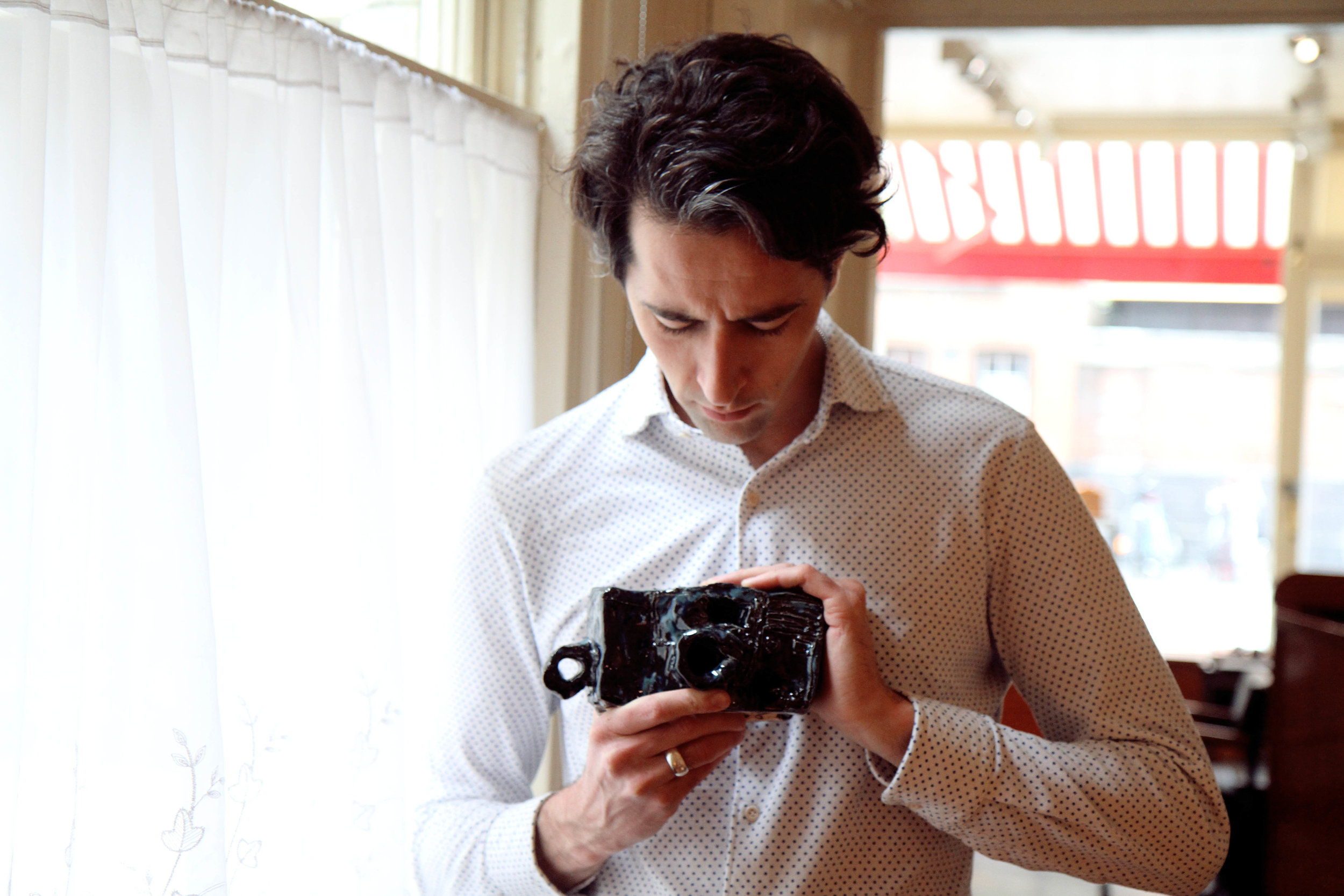 James Thomas holding an Alan Constable camera, 2017