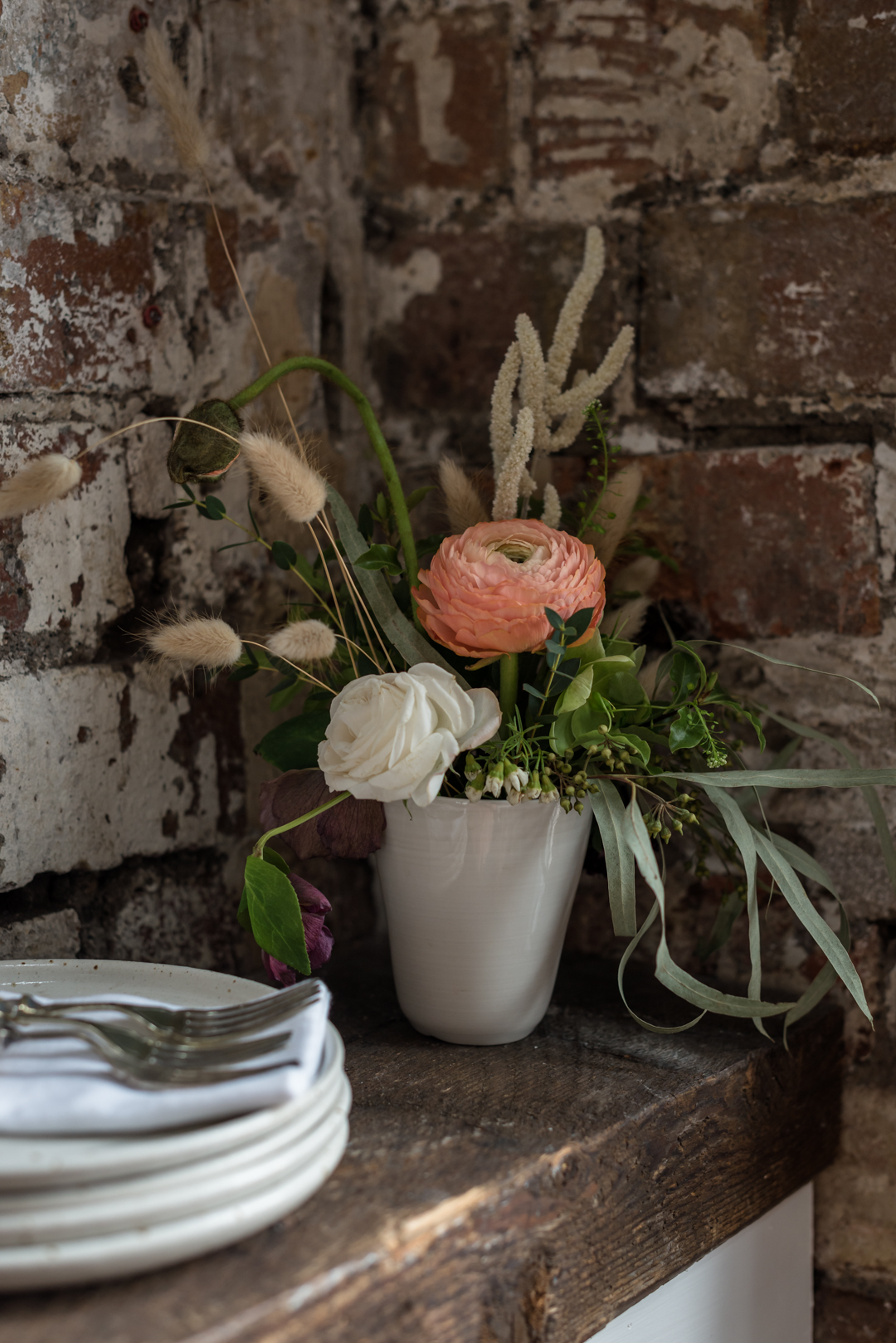 Pretty coral table flowers for private dining experience in centrail Bristol
