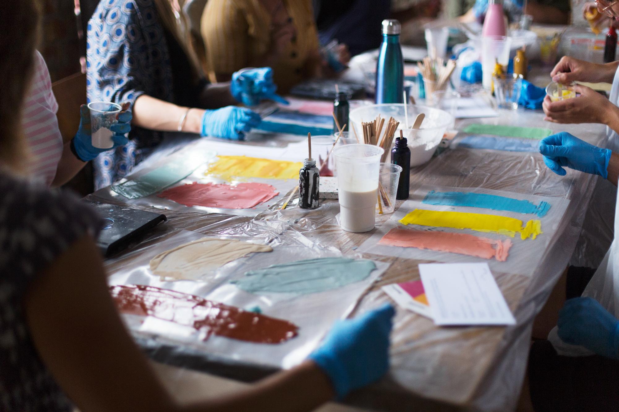 Modern art and craft classes in Bristol workshop. Attendees making Jesmonite Terrazzo tiles at workshop with Katie Gilles
