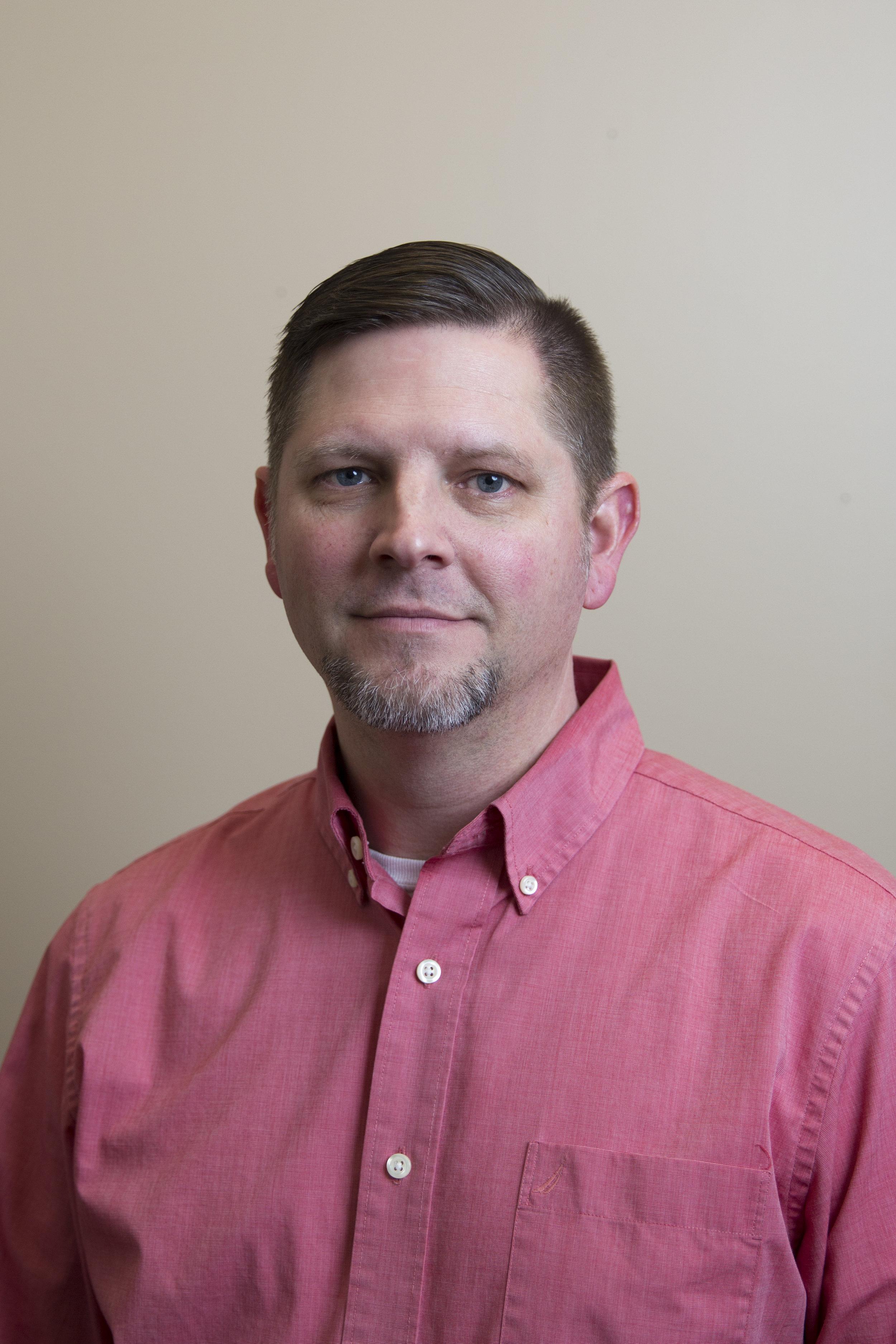 Dr. Christopher K. Cornine