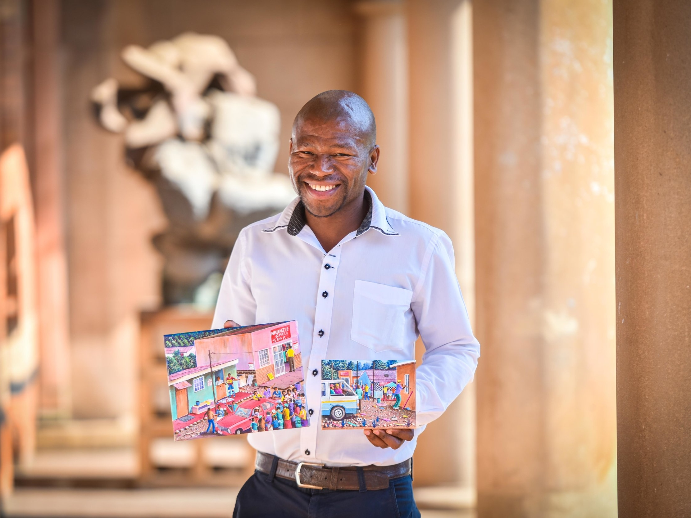 Pictured here is Siyabonga Sikosana handing over two artworks to FOTAG for the FABULOUS PICTURE SHOW 2016. See the FABULOUS PICTURE SHOW page for feedback on the sales.