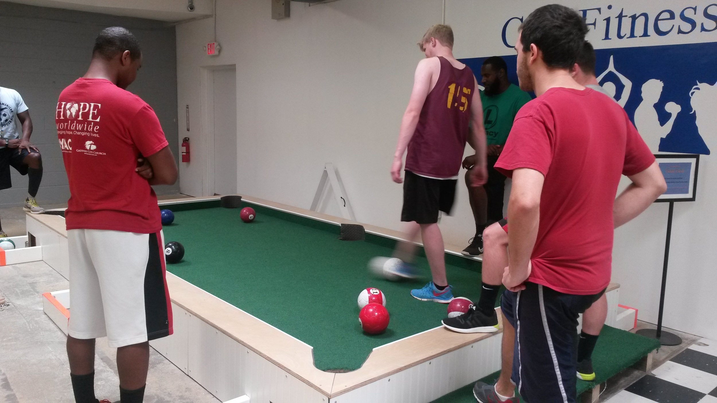 adults playing foot pool 2.jpg