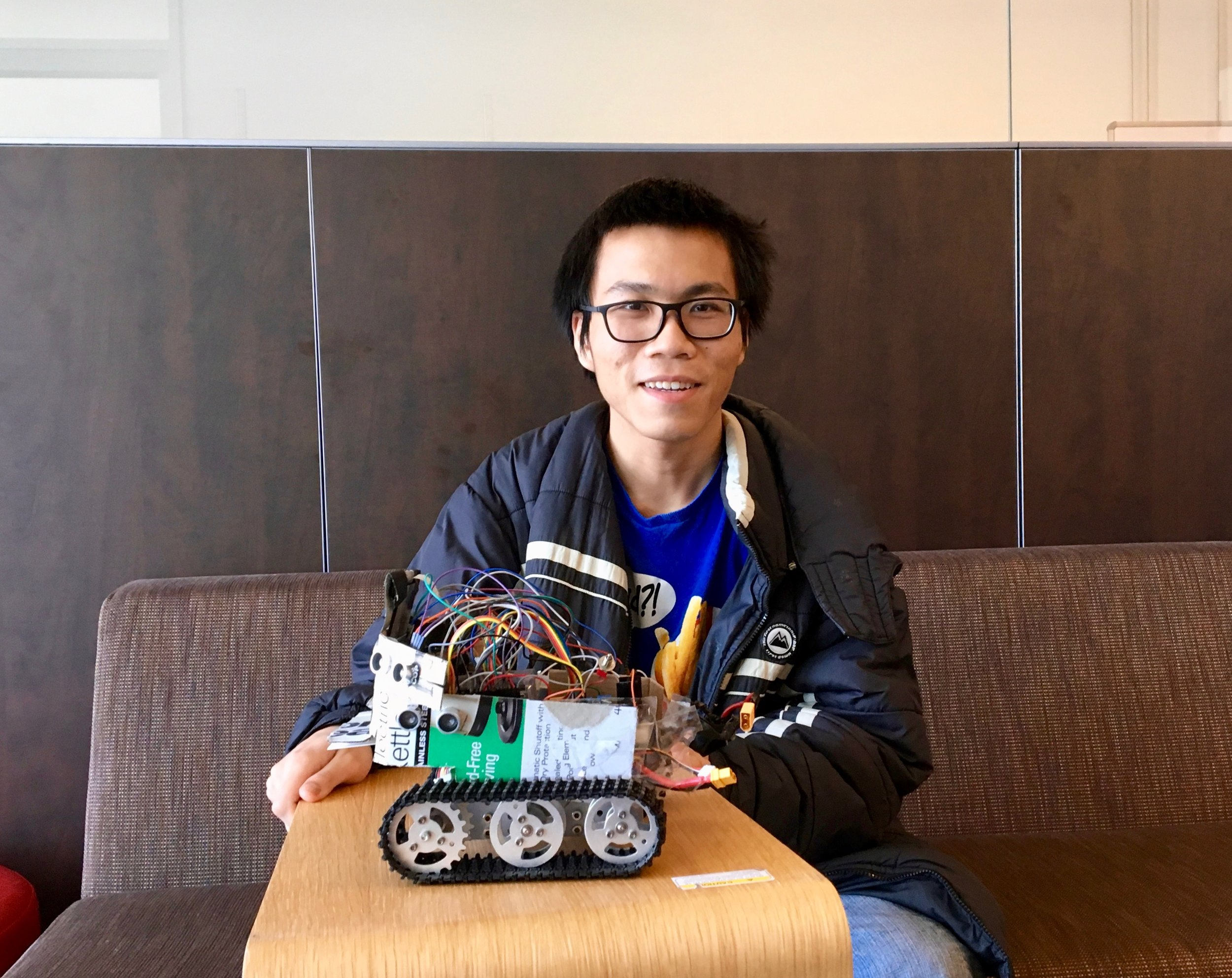 - Cao with one of his robots. This robot can detect its location using a gyroscope and Bluetooth.