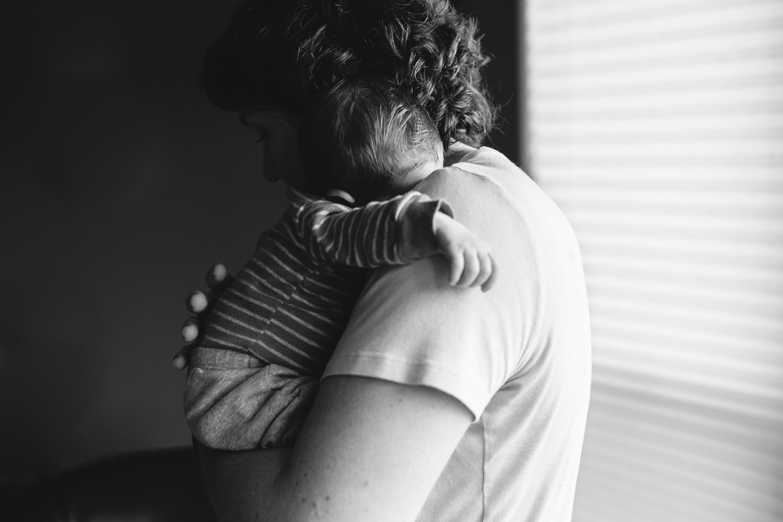 Mother holding her newborn sleeping son