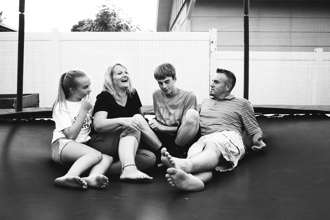 family of four having fun on the trampoline