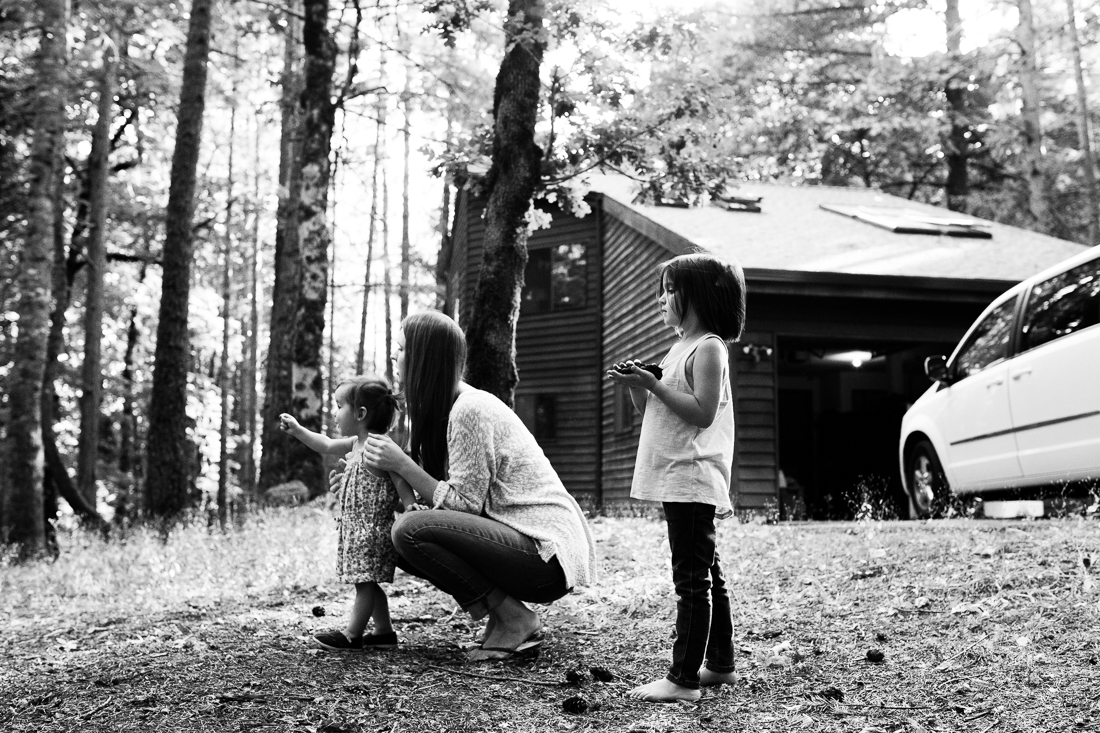 Mom with two girls outside exploring