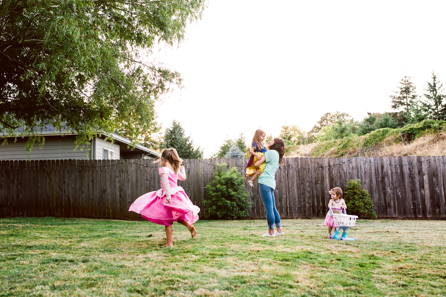 Mother and girls dancing in the backyard