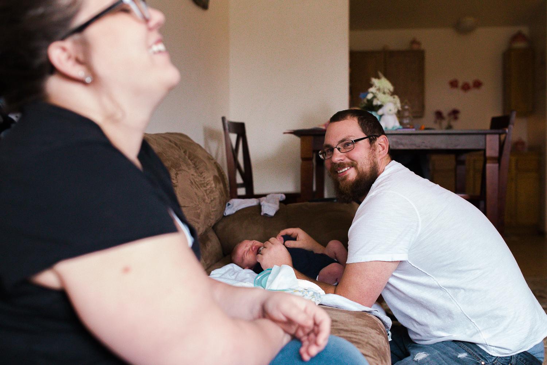 father holding his newborn son