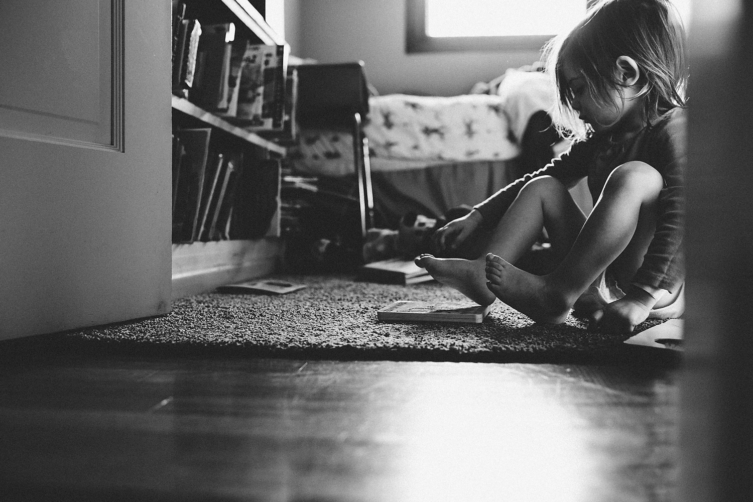 little girl quietly sitting in her room