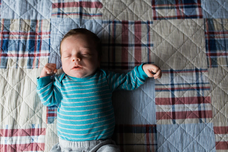 baby boy wearing a blue onesie