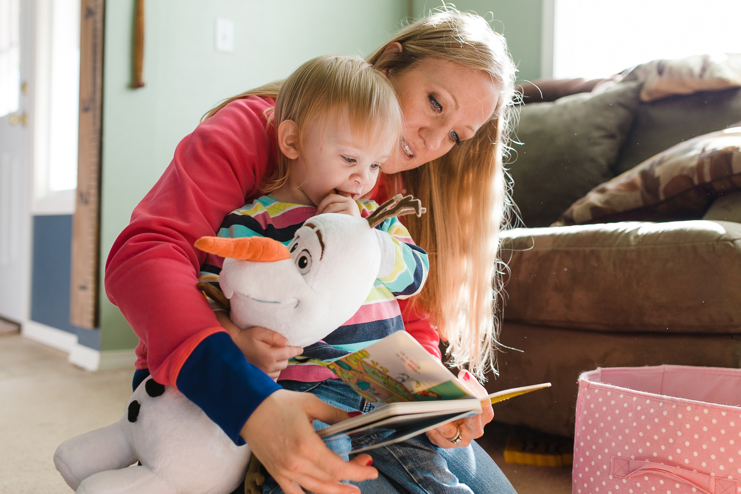 mom and girl reading a book together