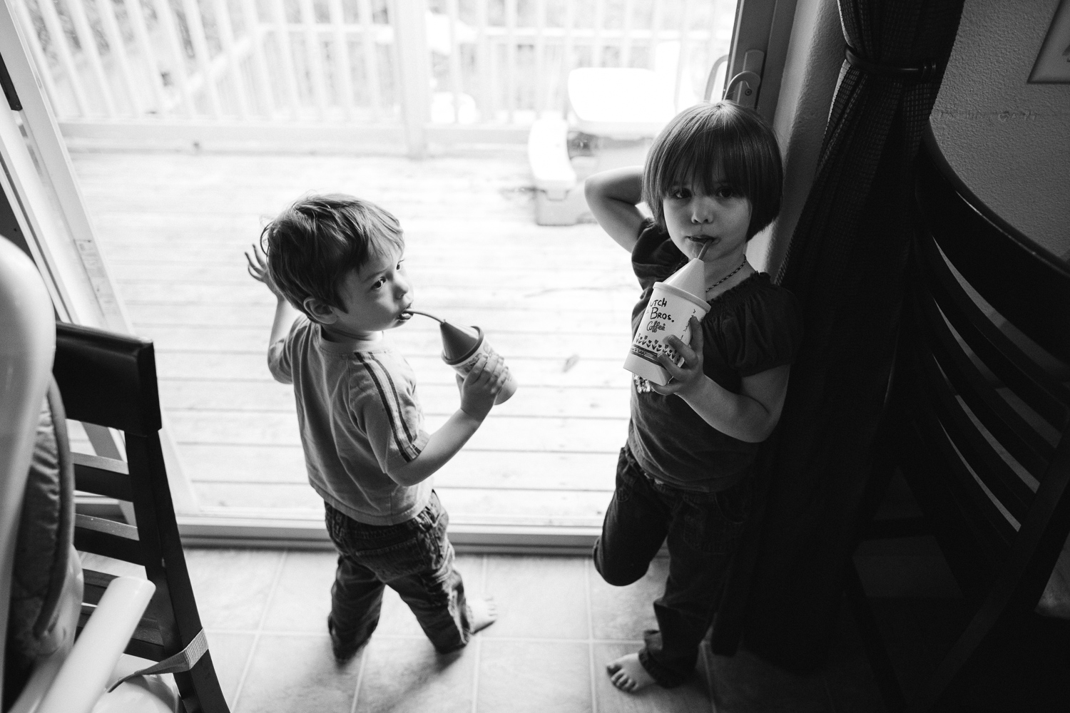 brother and sister drinking hot chocolate