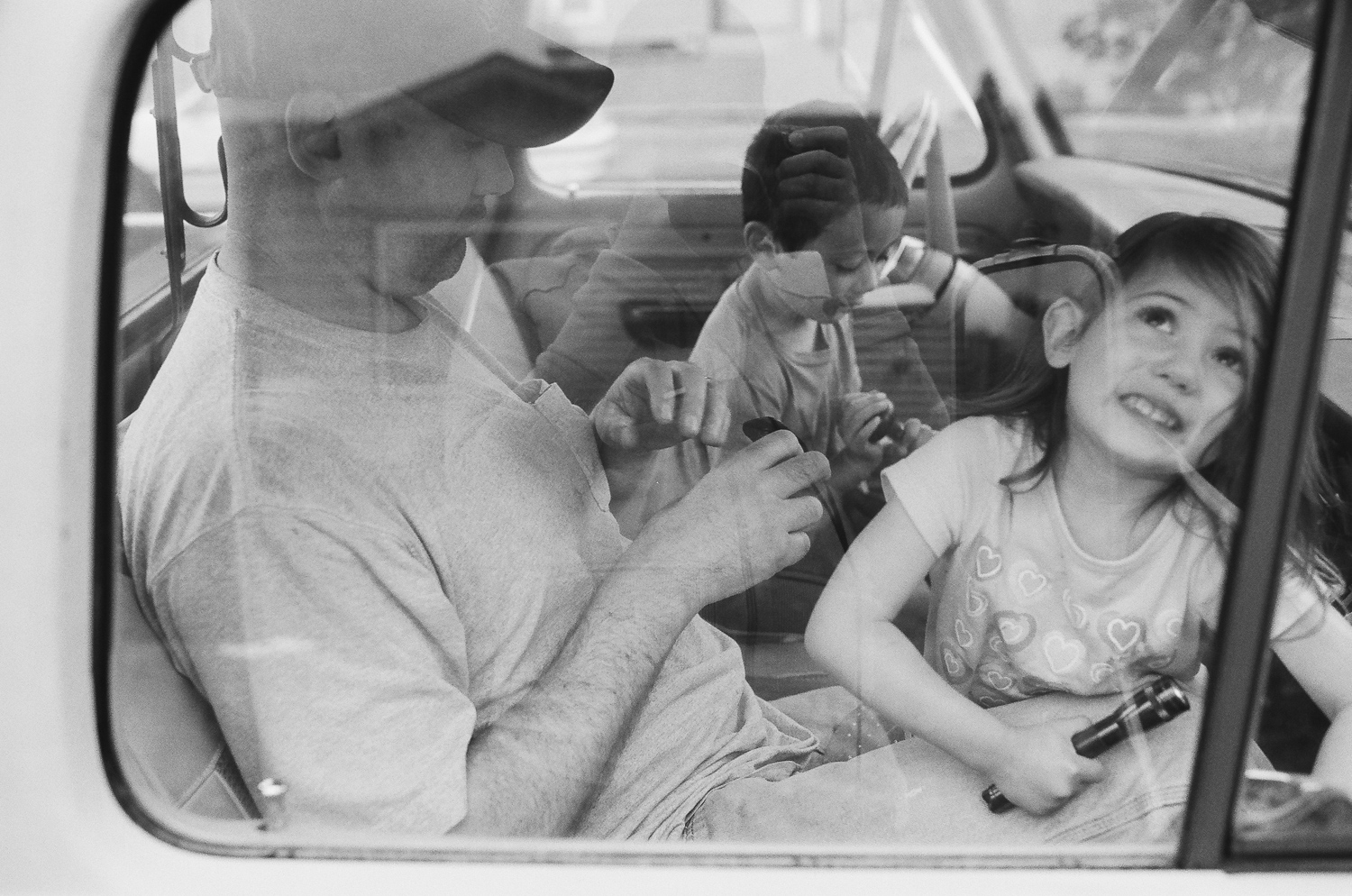 family playing inside the cab of a truck