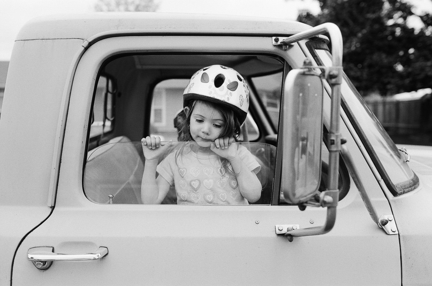girl playing in her dad's truck