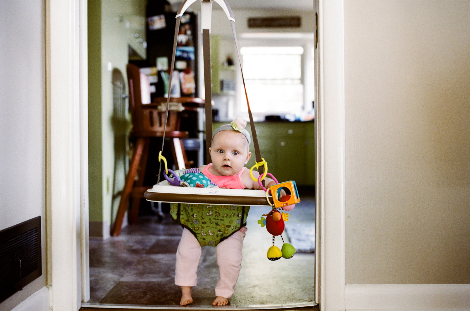 baby in green bouncer