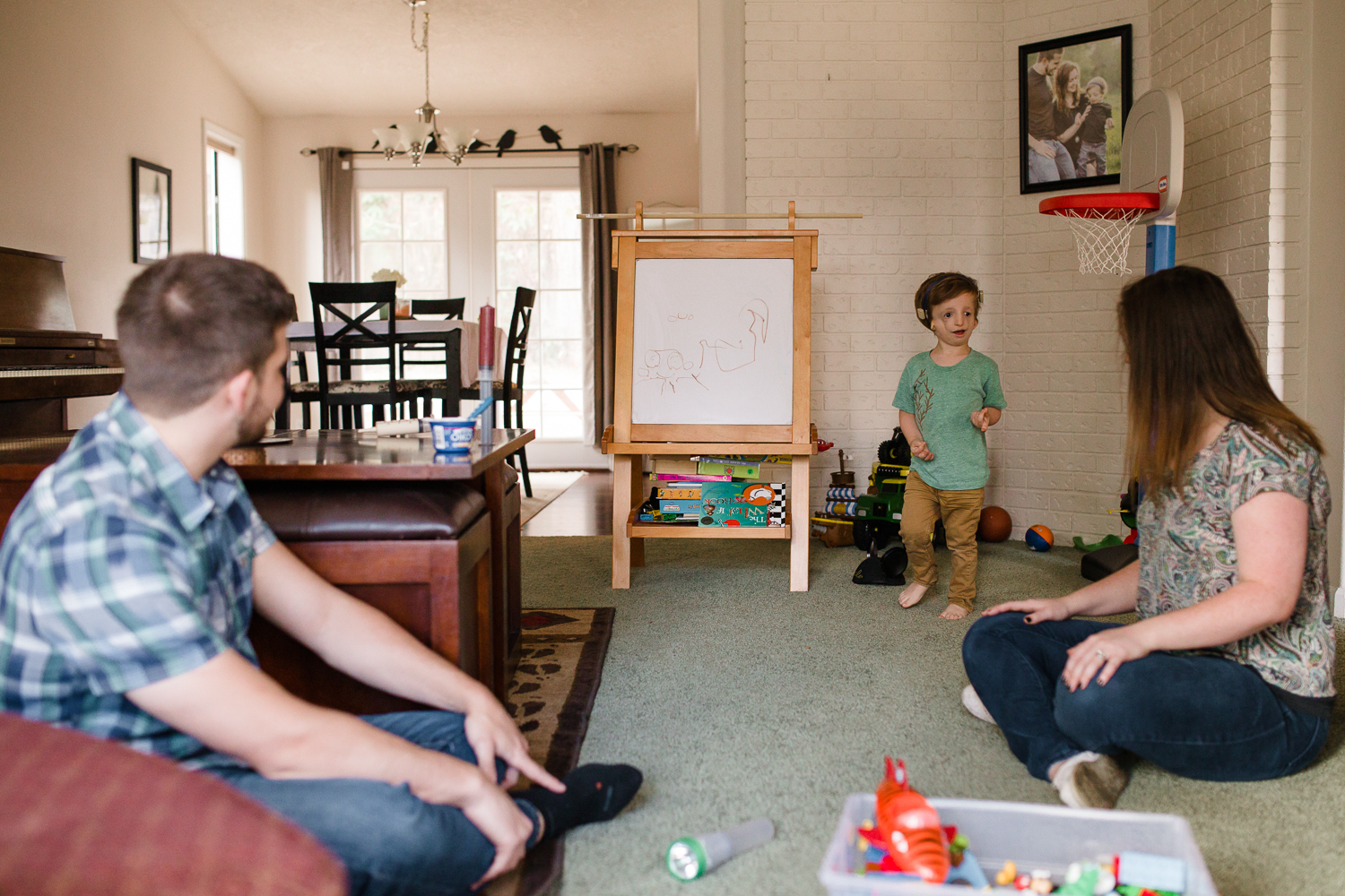 boy making art with parents