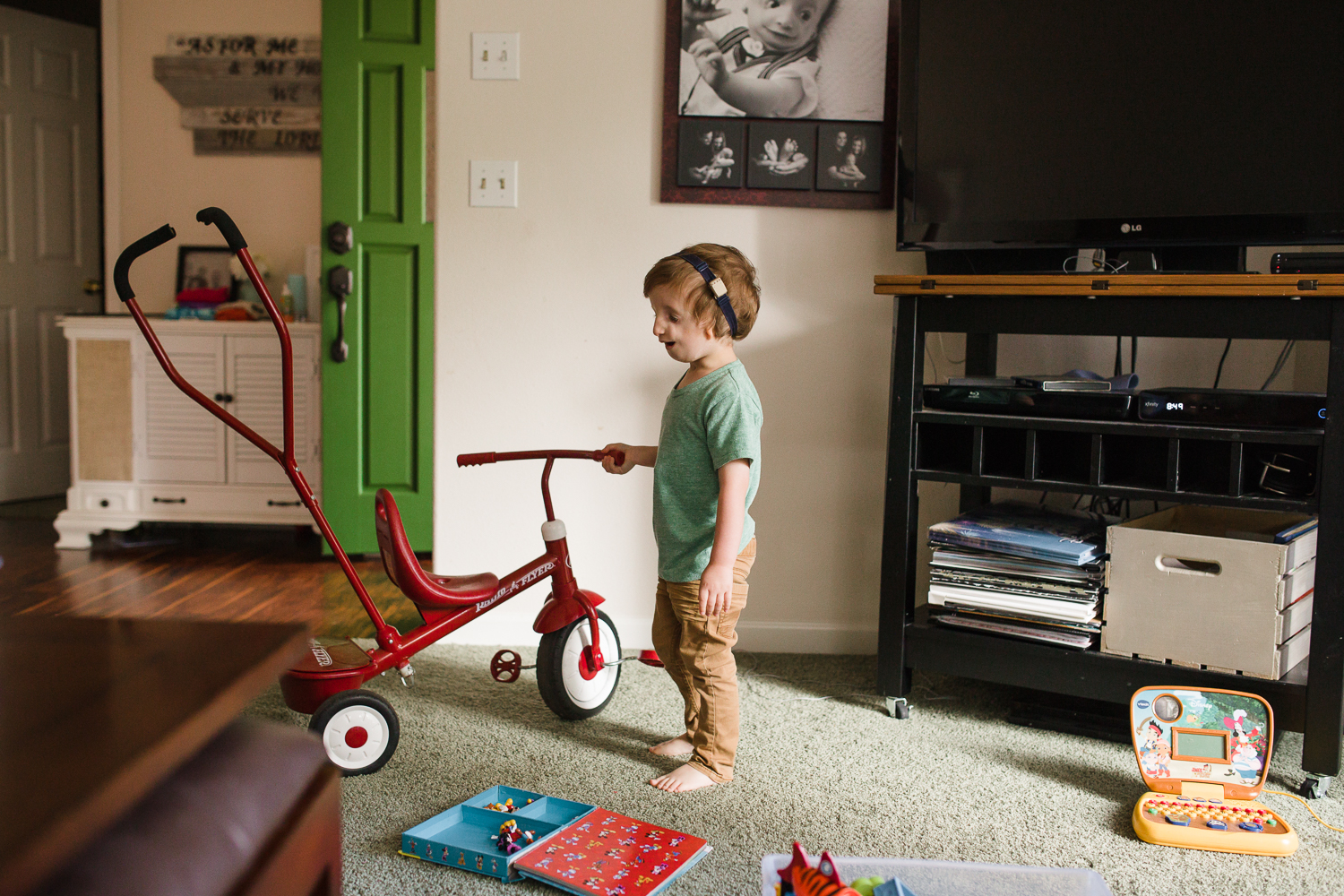 boy riding his red bicycle