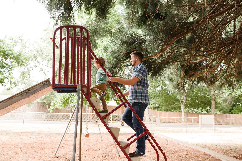 climbing up a ladder to go down a slide