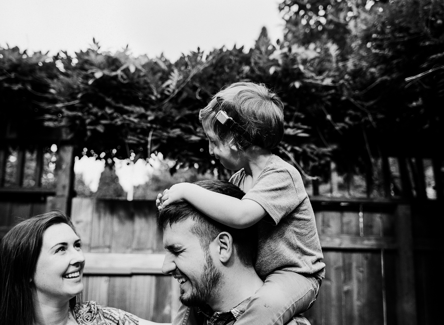 family smiling and laughing together