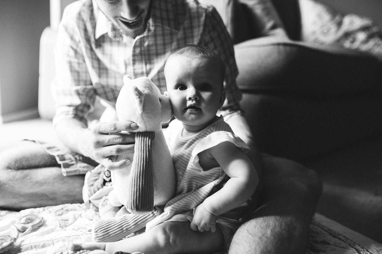 dad playing with his infant daughter