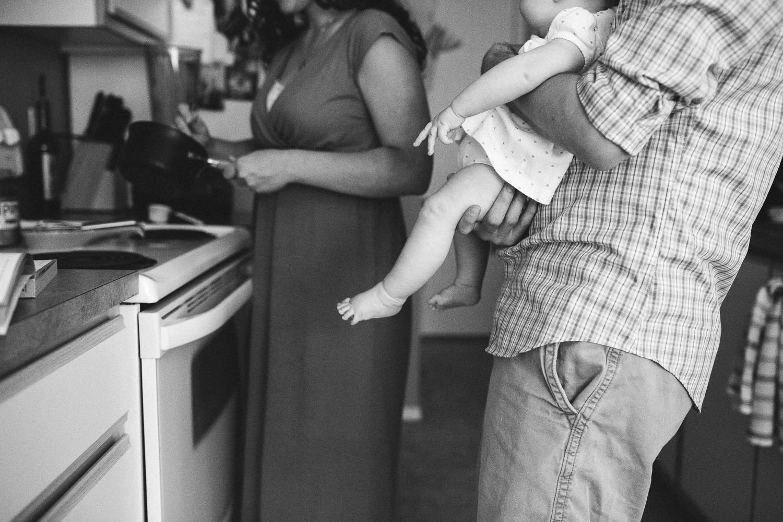 family in kitchen making dinner